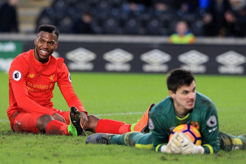Liverpool striker Daniel Sturridge spurning a goal-scoring chance against Hull, who upset the odds to beat Liverpool 2-0 at home. The Reds remain winless in the Premier League so far this calendar year, 13 points behind runaway leaders Chelsea.