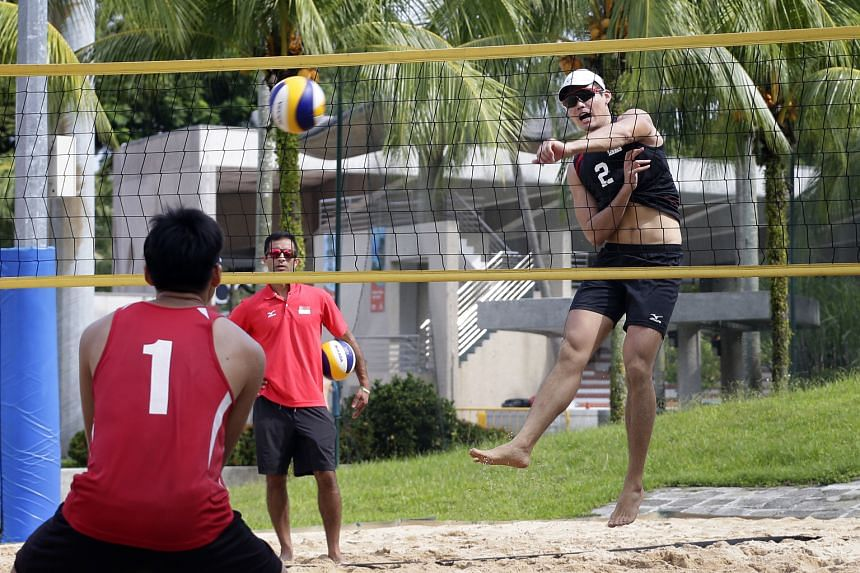 Dean Martin looks on as national beach volleyball player Mark Shen, 20, spikes during training on Sunday. The confidence expressed by the Canadian is already starting to rub off on his players.