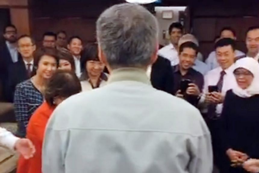 Strains of the birthday song filled the Members' Room at Parliament House yesterday as MPs threw Prime Minister Lee Hsien Loong a surprise party ahead of his 65th birthday on Friday. Minister for Social and Family Development Tan Chuan-Jin posted a F