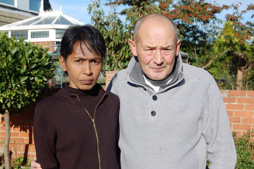Mrs Irene Clennell and her husband John in a photo taken last year, after finding out that she was to be deported to Singapore. She is fighting to be allowed to remain in Britain with her family.