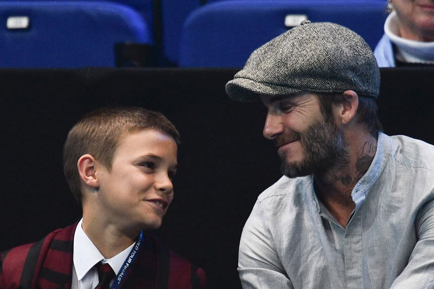 Former England footballer David Beckham and second son Romeo watching the ATP World Tour Finals in London last November. His team do not dispute some of the e-mails of him criticising the honours committee for not giving him a knighthood. But they st
