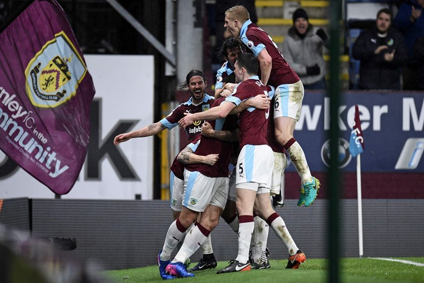 Welsh striker Sam Vokes (hidden) celebrating with Burnley team-mates after scoring against Leicester last month. It was the only goal of the match and took the Clarets' home league record this season to nine wins and a draw in 13 games.