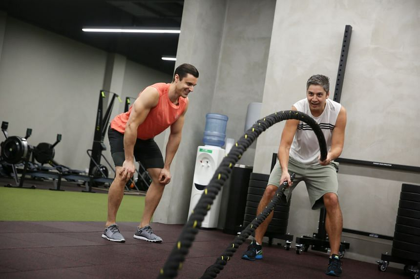 One FM 91.3 DJ Shan undergoing an arduous training session, conducted by TripleFit gym instructor Daniel de Sanctis in preparation for the upcoming Men's Health Urbanathlon.
