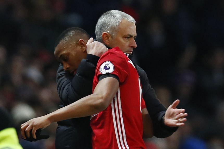 Anthony Martial is congratulated by United manager Jose Mourinho after being substituted. His goal and Juan Mata's opener secured the win.