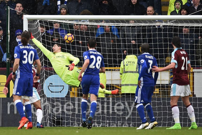 Chelsea's goalkeeper Thibaut Courtois cannot keep out Robbie Brady's masterful free kick which made it 1-1, marking the first time the Belgian had conceded directly from a free kick in the Premier League.
