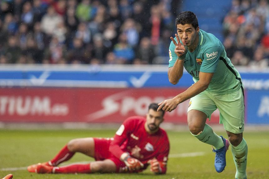 Barcelona striker Luis Suarez wheeling away in delight after scoring past Alaves goalkeeper Fernando Pacheco. Barca were irresistible as they thrashed Alaves 6-0 and will be looking for a repeat showing when the sides meet again in the Copa del Rey f