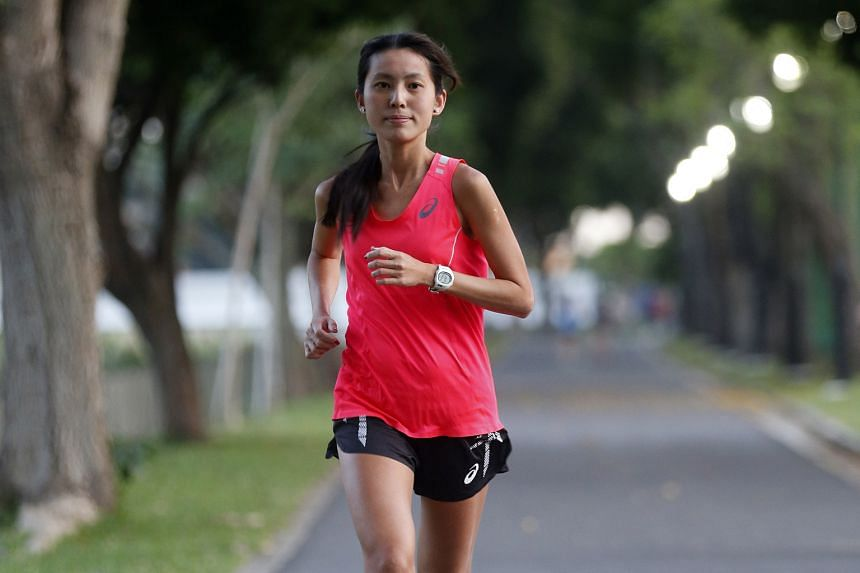 Marathon runners Jasmine Goh (above) and Rachel See have both met the SEA Games qualifying benchmark after their performances in the Hong Kong Marathon yesterday.