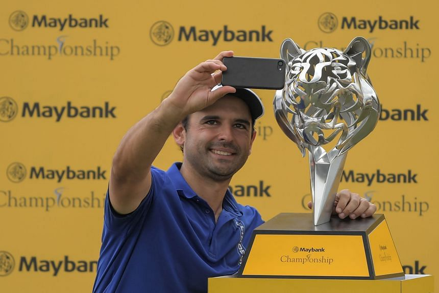 """Paraguayan Fabrizio Zanotti taking a selfie with his trophy, after shooting """"probably the best round"""" of his career at Saujana Golf and Country Club to win by one stroke."""