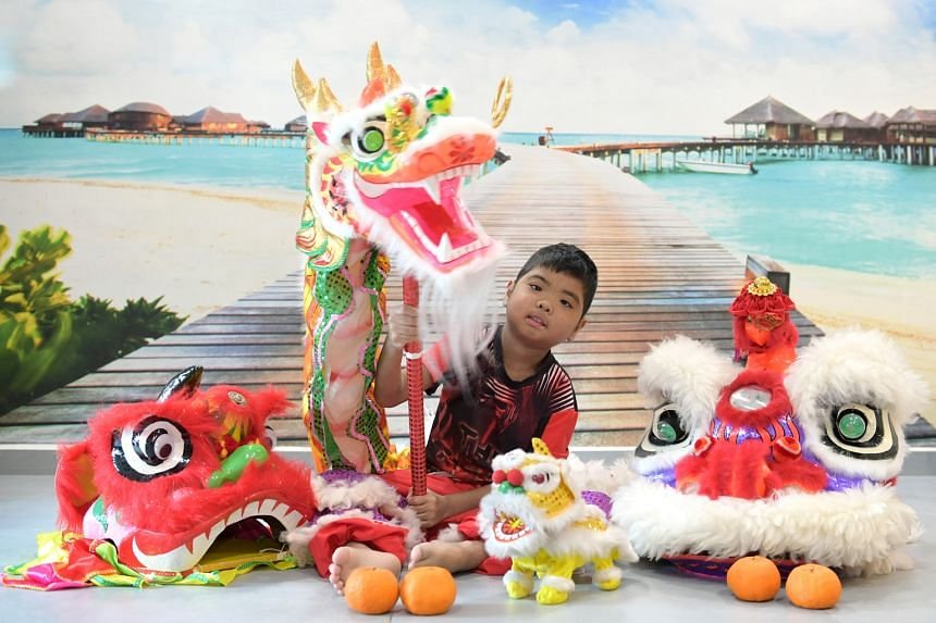 With two transplants behind him, Boon Kye Feng, now 10, can enjoy doing the lion dance.