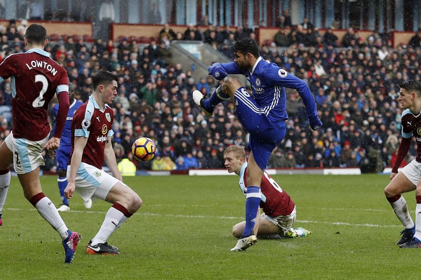 Chelsea's Diego Costa has his shot blocked by Burnley's Michael Keane in the 1-1 draw. Joint third on the EPL scorers list with 15 goals, he did not score for the third straight game.