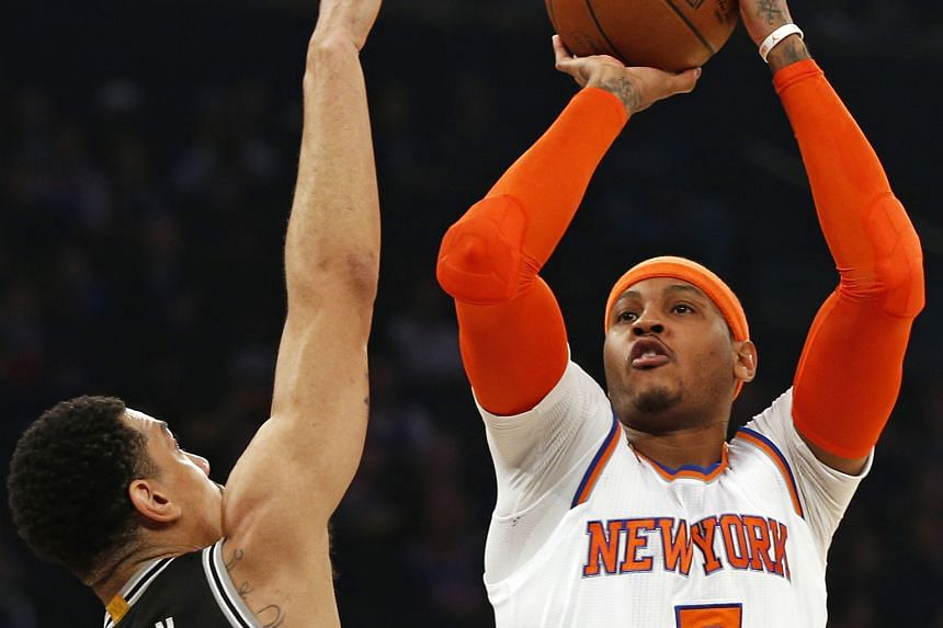 New York Knicks' Carmelo Anthony shooting over San Antonio Spurs' Danny Green. Anthony led his team in points, scoring 25 as New York beat San Antonio 94-90 in an unexpected victory.