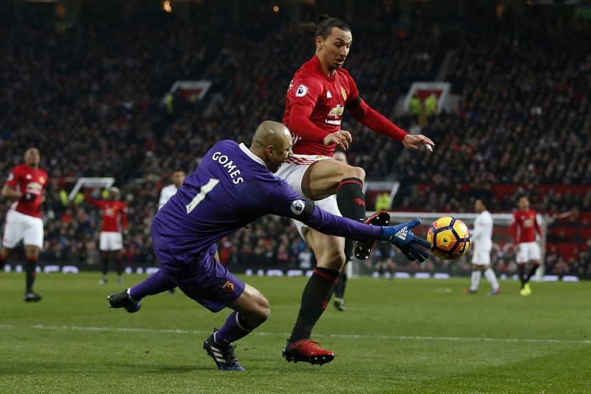 Manchester United striker Zlatan Ibrahimovic attempting to poke the ball away from Watford's Heurelho Gomes. The Swede, who is joint-third in the league's scoring standings with 15 goals, did not get on the scoresheet as United won 2-0.