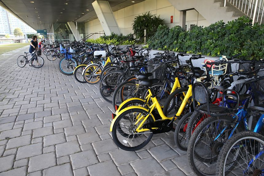 Chinese company ofo's bright yellow bicycles outside Punggol MRT station. Direct competitor Obike's white bicycles are already available for rent at almost every MRT station. Both plan to expand their fleet of bicycles. Experts reckon the two schemes
