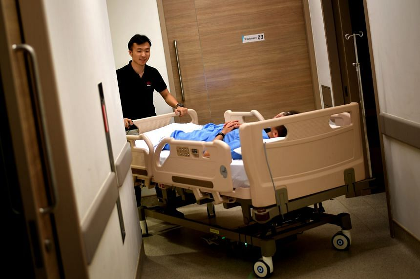 The Elleviate Bed Mover, a motorised device that helps nurses push heavy hospital beds around with ease. Mr Andrew Toh (left) and Mr Arron Li with a water jet cutter that is used to cut thick sheets of metal. Mr Li says engineers are encouraged to be