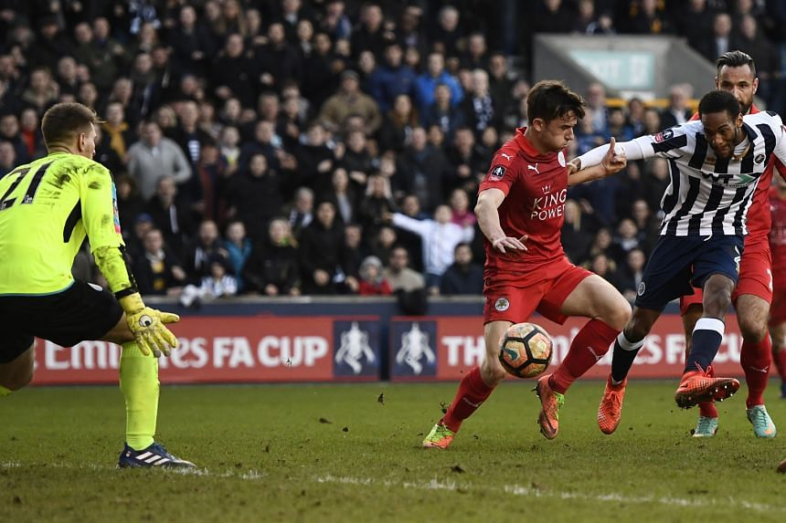 Millwall's Shaun Cummings slots home the only goal of the match in the 90th minute in the FA Cup fifth round on Saturday, sealing victory for the League One side. It was the seventh time in 10 games that Leicester had failed to score.