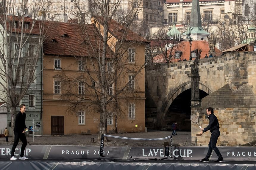 Swiss great Roger Federer (right) playing tennis with Czech Tomas Berdych on the Vltava River while promoting the Laver Cup, with Prague Castle in the background. The first Laver Cup, in honour of Australian legend Rod Laver, will pit six of the best