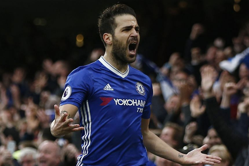 Chelsea's Cesc Fabregas celebrating after scoring his team's opening goal in the 3-1 Premier League win over Swansea at Stamford Bridge yesterday. Fernando Llorente equalised for the visitors before Pedro Rodriguez and Diego Costa sealed the win for