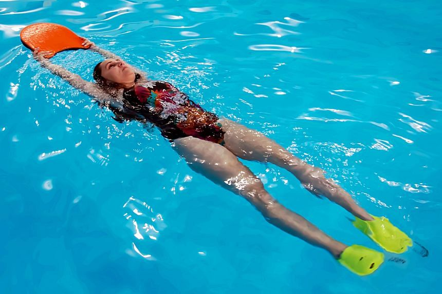 Swimming with fins allows you to work on your leg strength. Using different equipment in the pool, such as hand paddles, can also help you to work on your upper body.