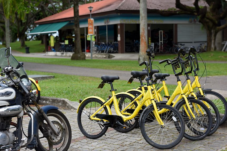 ofo's yellow bicycles parked illegally in motorcycle parking spaces in Pasir Ris Park, a short distance from a bicycle rental stand. Bike rental companies, which must win a public tender to operate in public parks, are crying foul over ofo's business