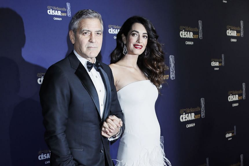 Hollywood actor George Clooney and his wife Amal, who is expecting twins in June, at the Cesars in Paris last week.