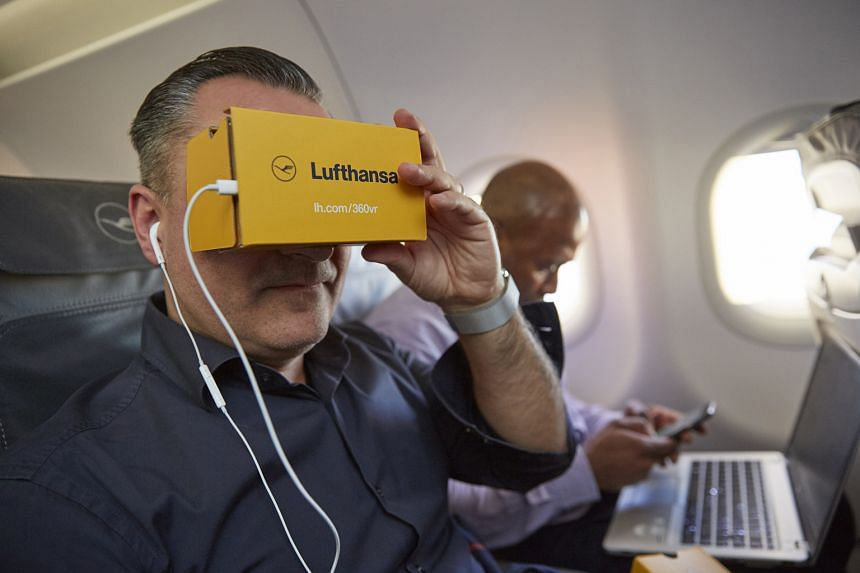 A guest trying out a Lufthansa 3D virtual reality information and entertainment app.