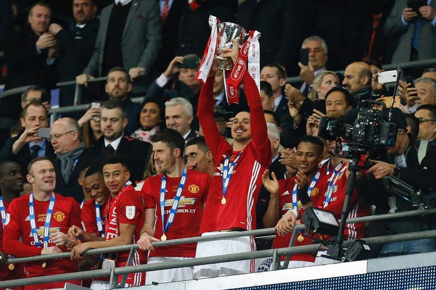 Man-of-the-Match Zlatan Ibrahimovic lifting the trophy as Manchester United players celebrate their League Cup final victory over Southampton at Wembley. The Swedish striker sealed the first major silverware of Jose Mourinho's Manchester United reign