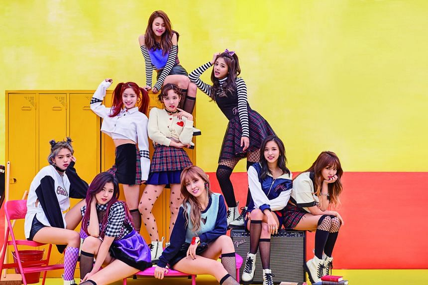 Girl group Twice comprise (front row, seated, from left) Jeongyeon, Sana, Momo, Mina, Jihyo, (second row, from left) Dahyun, Nayeon, Tzuyu and (last row) Chaeyoung.