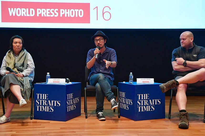 The panellists at yesterday's discussion, Photojournalism in the Age of New Media, were (from left) photography curator Yumi Goto and award-winning photographers Kazuma Obara and Warren Richardson.
