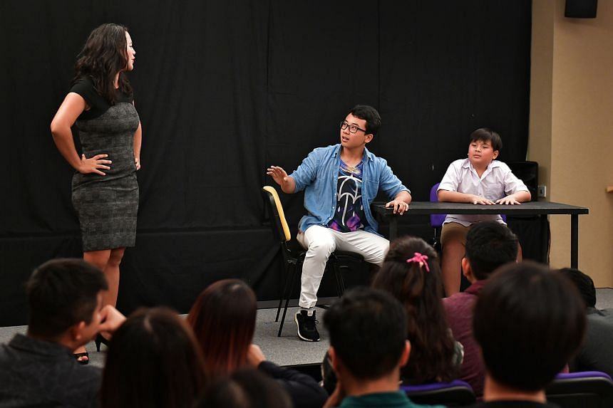 An audience member (in blue) jumping into the role of a father, in the play Don't Kancheong, Kiasu And Kiasi. The forum theatre piece was part of community group 100 Voices' campaign to collect feedback on how attitudes to education can be changed.