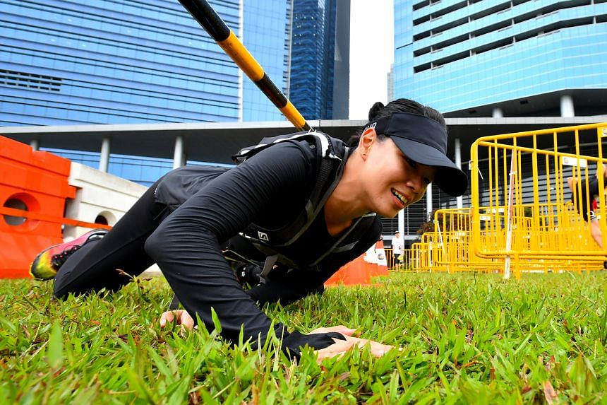 From top: A participant challenging himself at the Horizontal Salmon Ladder at Zone 4 at Ngee Ann City Civic Plaza. The Road Barricade at Zone 2 at the field opposite Marina Bay Financial Tower 3 is an obstacle which tests one's agility. The highligh