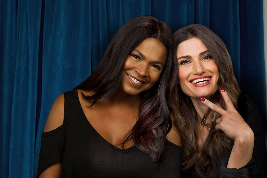 Idina Menzel (right) takes on the role of CC Bloom in a made-for-television film reboot of Beaches, which also stars actress Nia Long (both above).