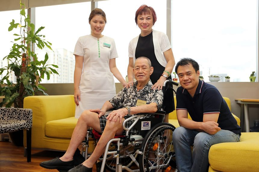 (From left) Patient navigator Miss Tan, Mrs Lee and her father-in-law Mr Lee, and Mr Andrew Soh from the Tsao Foundation's Hua Mei Centre for Successful Ageing. Mr Lee attends the centre every weekday, where he is placed under an eldercare programme.