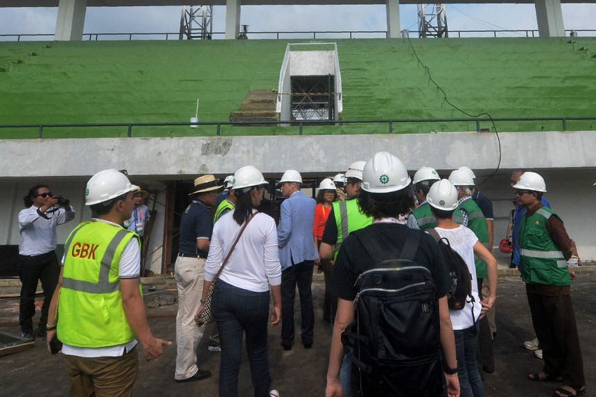 OCA officials visiting a yet-to-be-completed Asian Games venue at the Senayan sport complex in Jakarta. The 2018 Games organisers have had to contend with a raft of issues from graft to red tape.