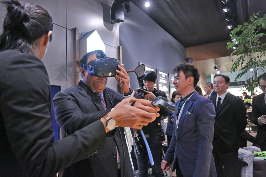 Mr S. Iswaran sampling the latest innovations at the VR Zone at the International Furniture Fair Singapore yesterday. The Minister for Trade and Industry (Industry) said adopting new technologies, such as VR and e-marketplaces, is key to the furnitur