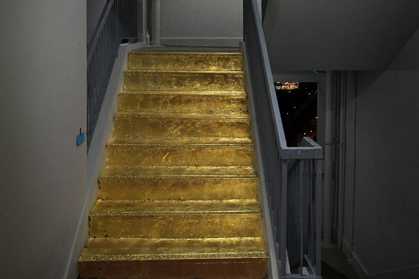 """The """"golden staircase"""" on the 20th floor of Block 103, Jalan Rajah. Ms Dia's work earned her praise from netizens, but the Jalan Besar Town Council pointed out that it was not permissible under the council's by-laws."""