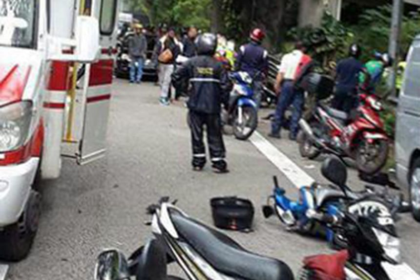 Some motorcyclists on the Bukit Timah Expressway had stopped on the road shoulder under a flyover to put on their raincoats when, according to Mr Chin Poh Fatt, one of the victims, a van drove into them.