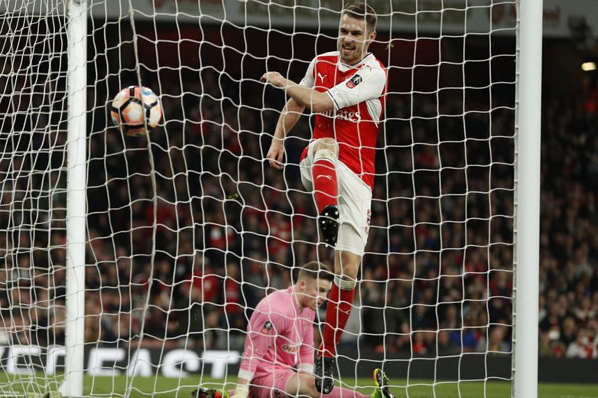 Midfielder Aaron Ramsey walking in Arsenal's fifth goal against non-league Lincoln City in the FA Cup quarter-finals.