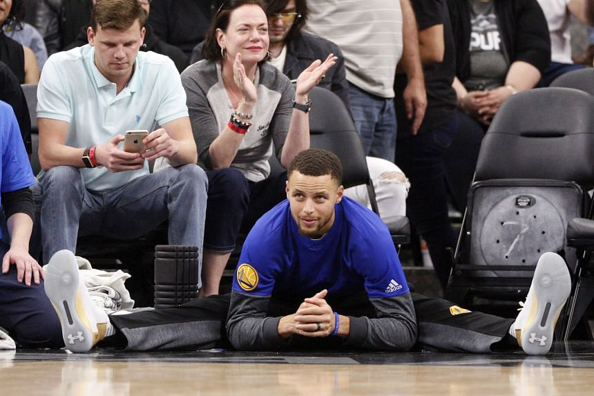 Warriors' Stephen Curry watching his team-mates take on the Spurs from the sidelines. The All-Star was rested along with other key Warriors.