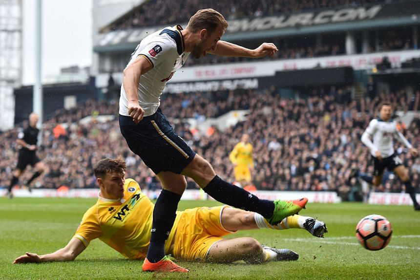 Tottenham striker Harry Kane is tackled by Millwall defender Jake Cooper as he shoots at goal during the FA Cup quarter-finals. Spurs won the match 6-0 but they lost Kane to an ankle injury.