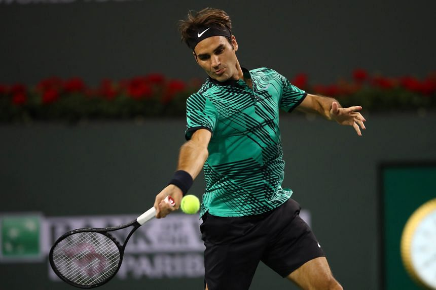 Roger Federer playing a forehand shot in his straight-sets victory against Stephane Robert, whom he met for the first time. He and fellow tennis great Rafa Nadal must both win their third-round matches in order to face off in the round of 16.