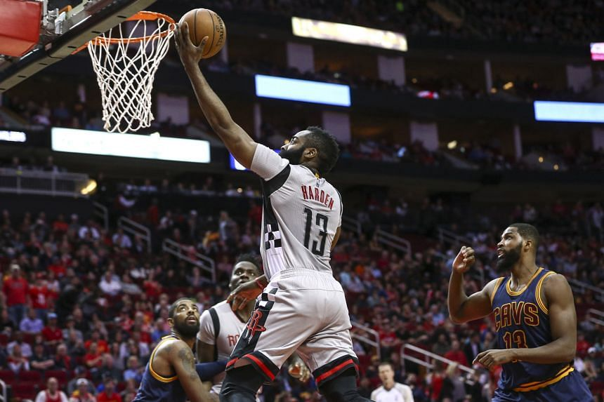 Houston's James Harden scoring a basket during the first quarter against Cleveland at Toyota Centre. The Rockets beat the Cavs 117-112.
