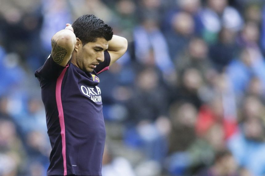 "A frustrated Luis Suarez, who scored Barcelona's equaliser at Deportivo. Poor defending from corners cost them in the 1-2 loss, as they conceded top spot in La Liga to Real and Barca manager Luis Enrique knows they need a ""very strong"" finish to secu"