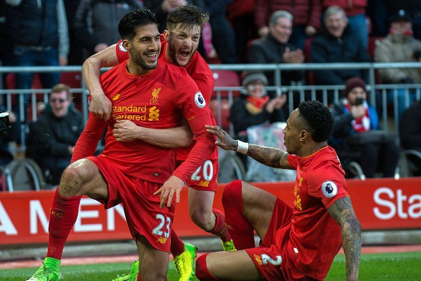 Liverpool's Emre Can (left) celebrating with Adam Lallana and Nathaniel Clyne after scoring in the 2-1 win over Burnley.