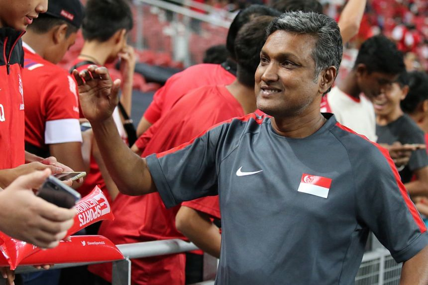 Coach V. Sundramoorthy thanking fans at last October's Causeway Challenge. He and FAS technical director Michel Sablon have had their contracts extended by two years.