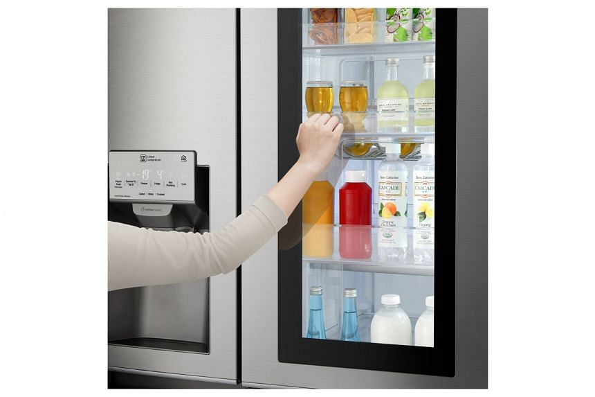 The transparent glass panel of the LG Signature InstaView Door-in-Door fridge lets you see what's in the side compartment without having to open the door.