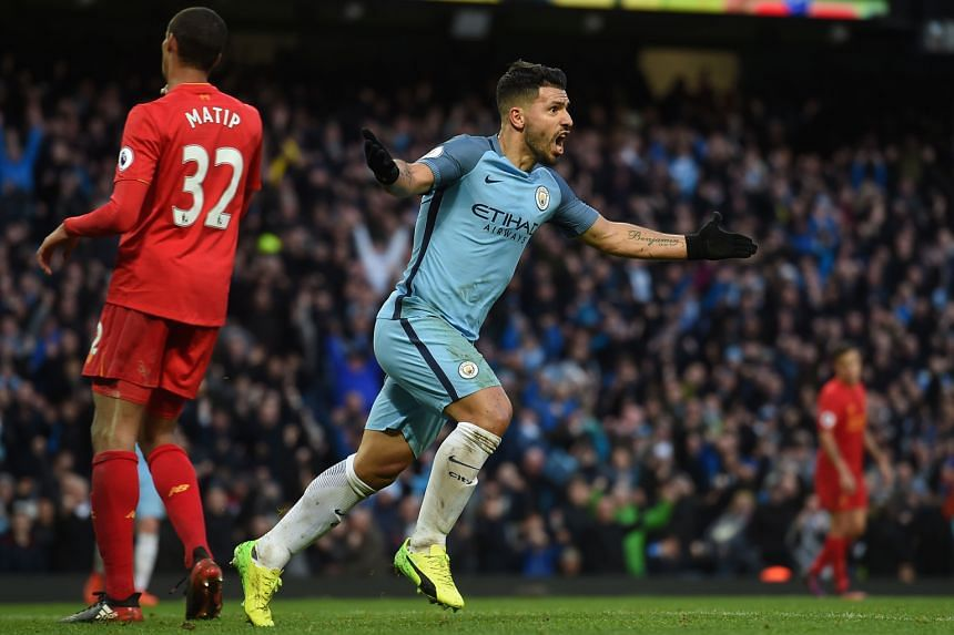 Manchester City striker Sergio Aguero turning away in celebration after equalising in the 69th minute as City drew 1-1 with Liverpool at home. Only one point separates both teams.