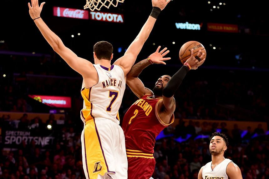 Cavs guard Kyrie Irving scoring on a lay-up past Lakers forward Larry Nance Jr in a 125-120 win at the Staples Center after a fourth-quarter spurt. The Cavaliers go 46-23 with the win and extend their Eastern Conference lead over the Boston Celtics t
