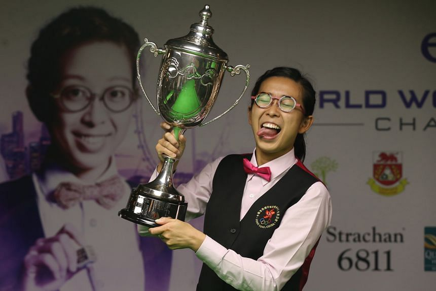 Ng On Yee savouring the fruits of her success at Safra Toa Payoh's Lagoon Billiard Room. She began her day at 10am on Sunday when she took on defending champion and world No. 1 Reanne Evans in the semi-finals, and it ended around 1.30am yesterday whe