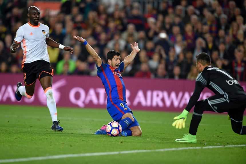 Barcelona's Uruguayan forward Luis Suarez appealing for a penalty when brought down by Valencia's Eliaquim Mangala at the Nou Camp Stadium. The French defender was sent off and Lionel Messi put the hosts 2-1 up from the spot. Barca won 4-2.