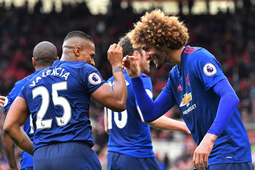 Manchester United right-back Antonio Valencia celebrating his 90th-minute goal with midfielder Marouane Fellaini. United will next play West Brom in the league as they continue their push on two fronts